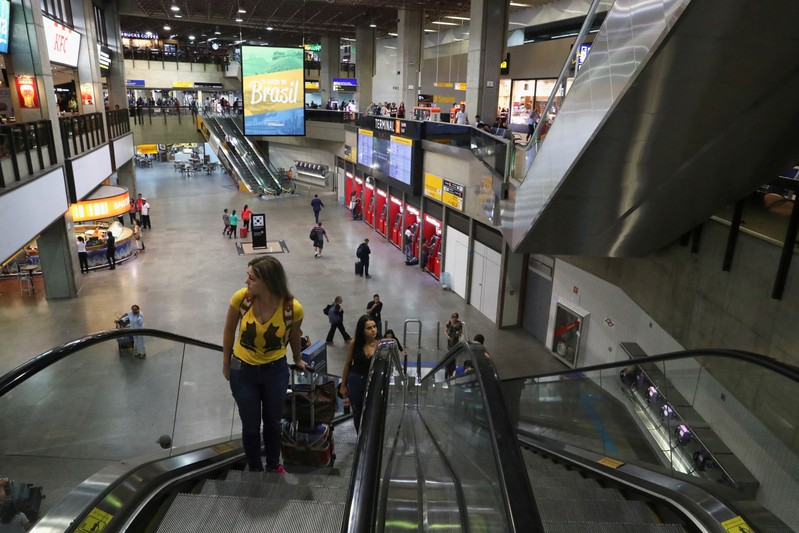 FILE PHOTO: People are seen at the check in area in Guarulhos international airport, near Sao Paulo