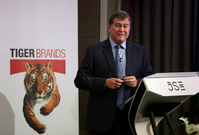 FILE PHOTO: Tiger Brands Chief Executive Lawrence MacDougall speaks during the release of their interim results in Johannesburg