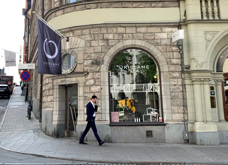 A man walks past Oriflame concept store in Stockholm