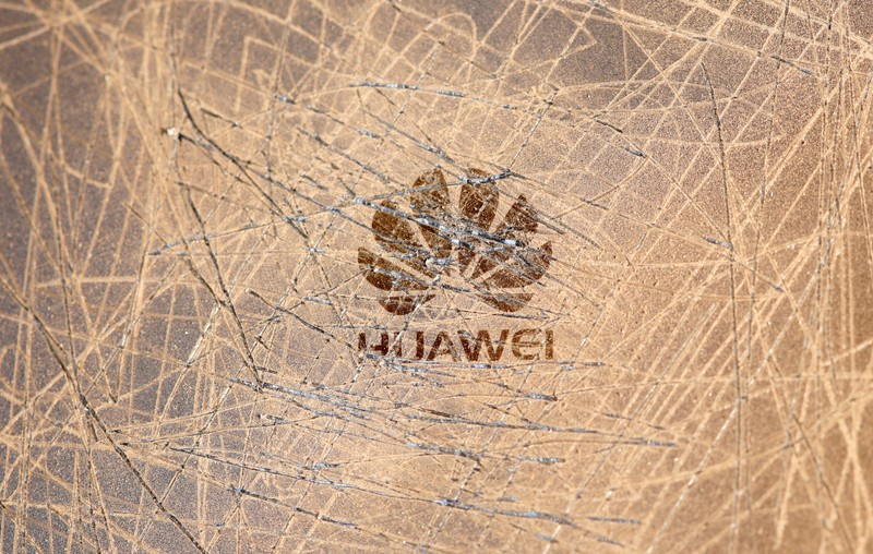 FILE PHOTO: A scratched surface Huawei logo is seen on a smarthphone in this illustration picture