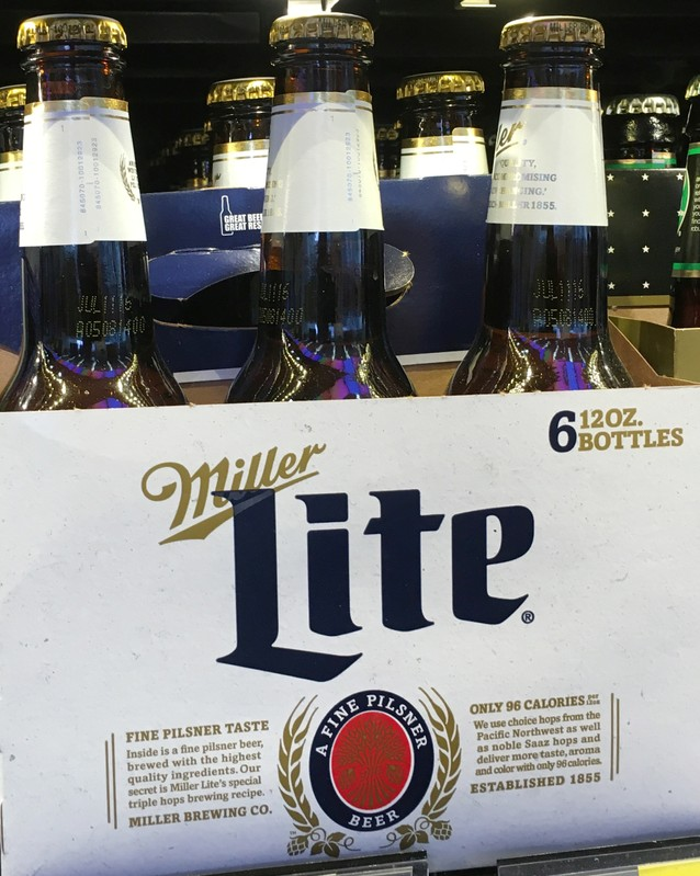 FILE PHOTO: Miller Lite beer bottles are seen for sale at a store in Manhattan, New York