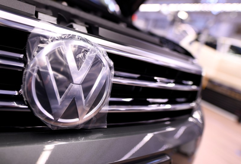 FILE PHOTO: A Volkswagen logo is pictured in a production line at the Volkswagen plant in Wolfsburg