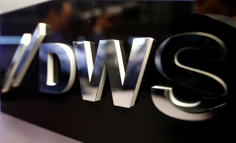 FILE PHOTO: Logo of Deutsche Bank's asset management unit DWS is pictured at the Frankfurt Stock Exchange