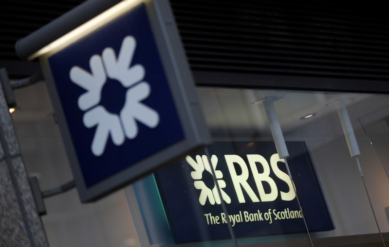 Royal Bank of Scotland signs are seen at a branch of the bank, in London