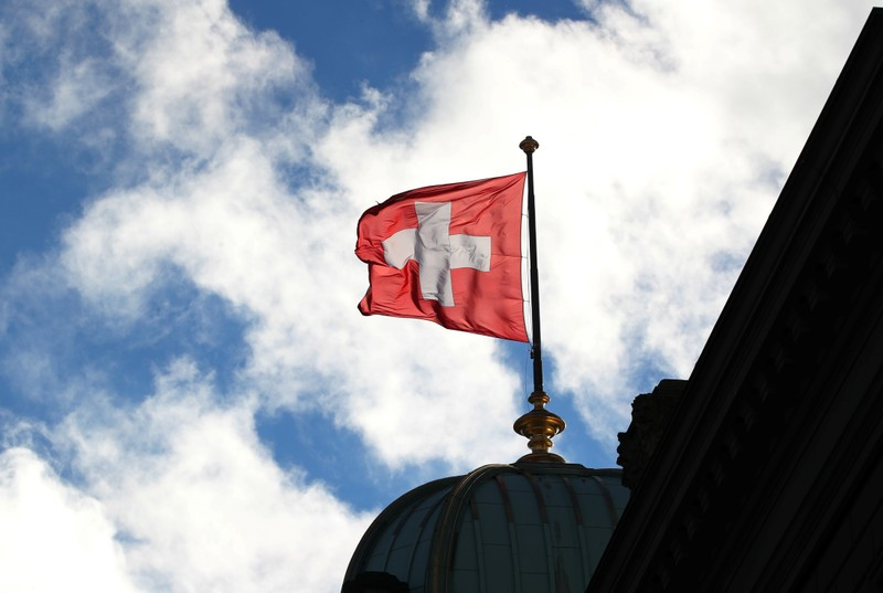 A Swiss flag is pictured on the Federal Palace in Bern