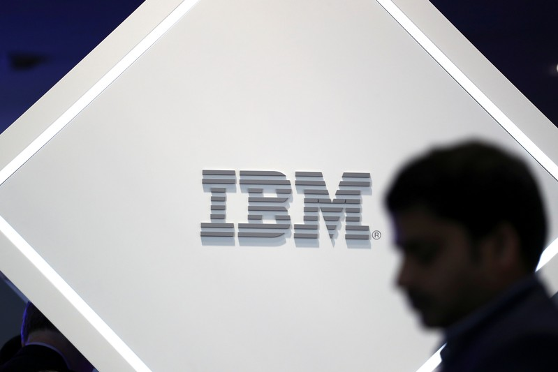 A man stands near an IBM logo at the Mobile World Congress in Barcelona