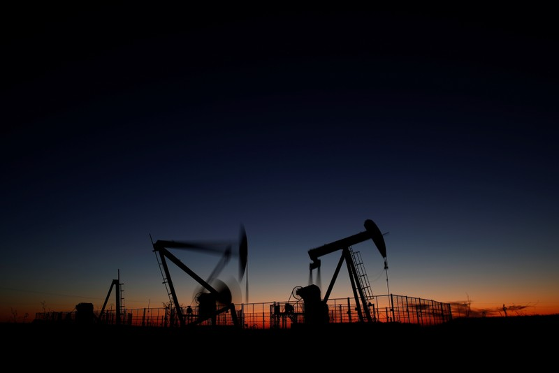 Oil pumps are seen after sunset outside Vaudoy-en-Brie