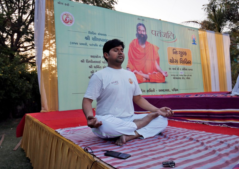 A man performs yoga during a yoga camp organised by Patanjali in Ahmedabad