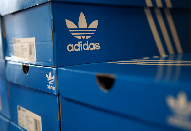 Boxes of Adidas shoes are pictured in the warehouse of local footwear retailer