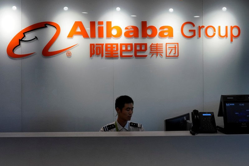 FILE PHOTO: The logo of Alibaba Group is seen inside DingTalk office, an offshoot of Alibaba Group Holding Ltd, in Hangzhou