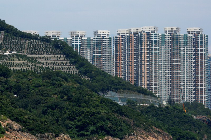 FILE PHOTO: Private residential blocks are seen behind a cemetery in Hong Kong