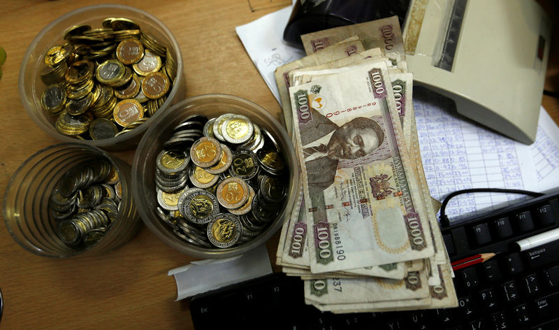Kenya shilling coins and notes are pictured inside a cashier's booth at a forex exchange bureau in Kenya's capital Nairobi