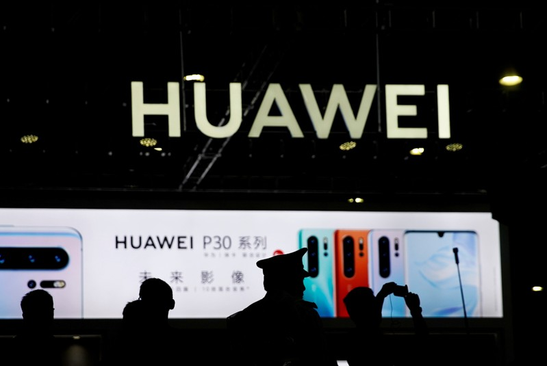 FILE PHOTO: A Huawei company logo is seen at CES Asia 2019 in Shanghai