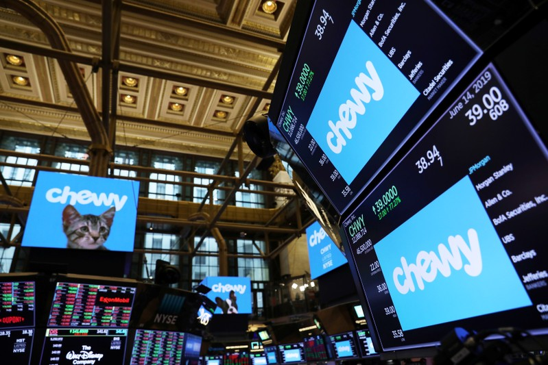 Logos for Chewy Inc. are displayed on the trading floor on the morning of the company's IPO at the New York Stock Exchange (NYSE) in New York City