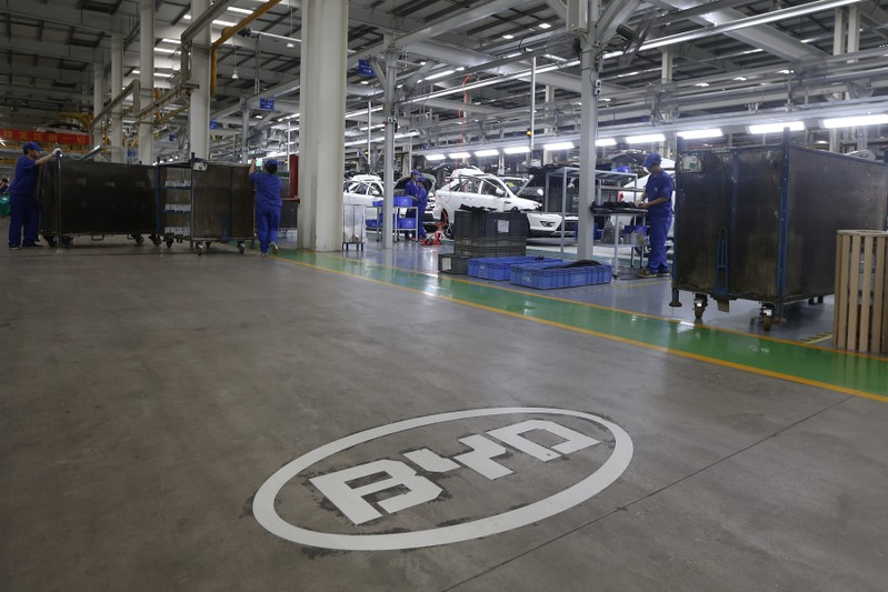 A logo of BYD is painted inside an assembly line of the automobile maker in Shenzhen