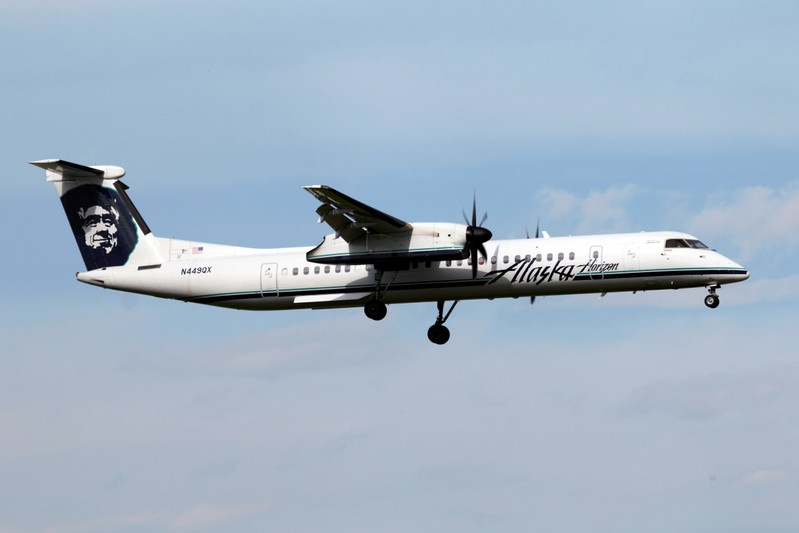 A Horizon Air Bombardier Dash 8 Q400 lands at Calgary airport