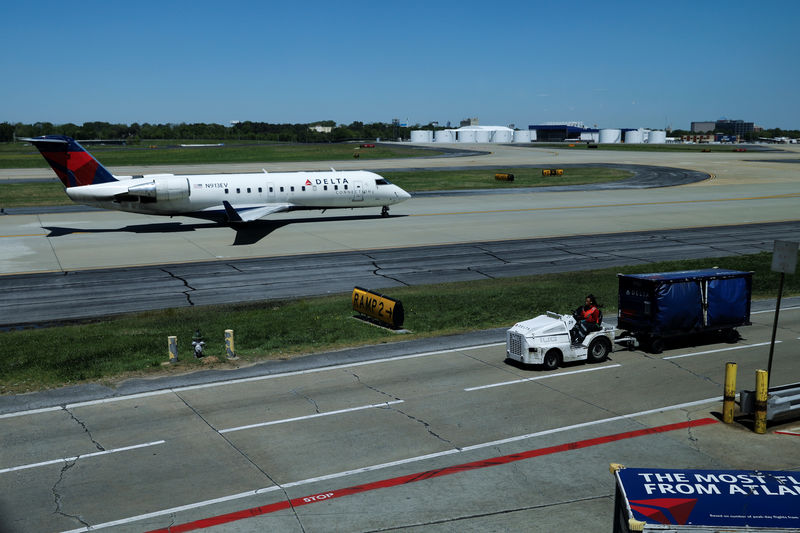 FILE PHOTO: A Delta Connection CRJ-200ER taxis for departure from  Hartsfield-Jackson International Airport in Atlanta