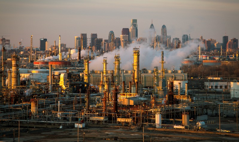 FILE PHOTO: The Philadelphia Energy Solutions oil refinery is seen at sunset in front of the Philadelphia skyline
