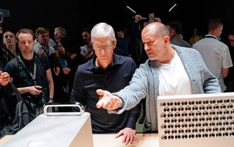 Apple CEO Tim Cook and Chief Design Officer Jonathan Ive look over the new Mac Pro during Apple's annual Worldwide Developers Conference in San Jose