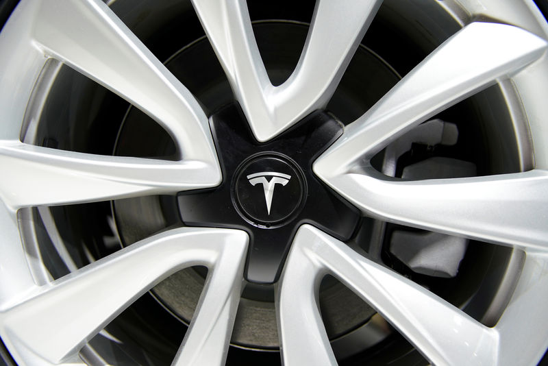 Tesla logo is seen on a wheel rim during the media day for the Shanghai auto show in Shanghai