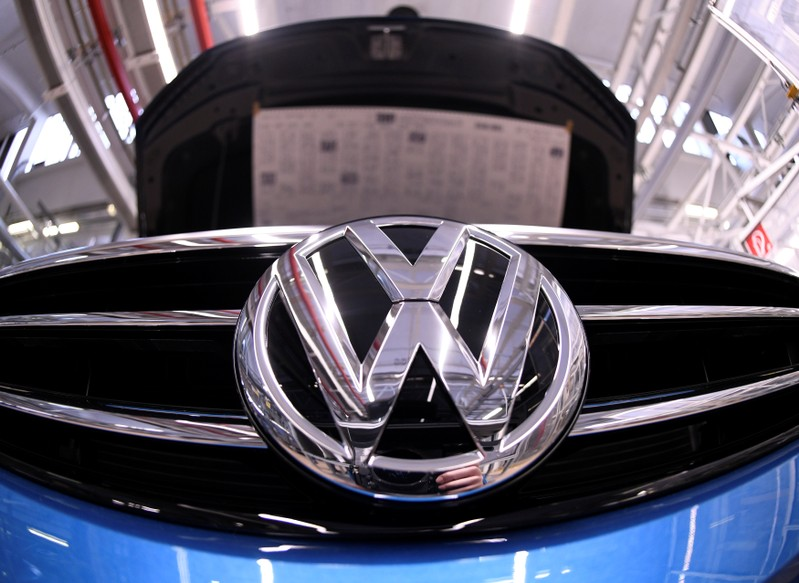 A Volkswagen logo is pictured in a production line at the Volkswagen plant in Wolfsburg