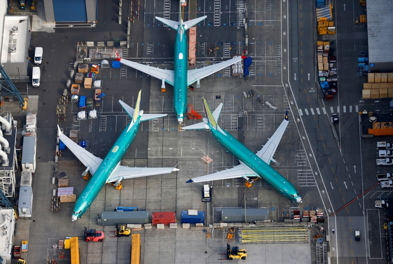 A photo of Boeing 737 MAX airplanes parked on the tarmac at the Boeing Factory in Renton