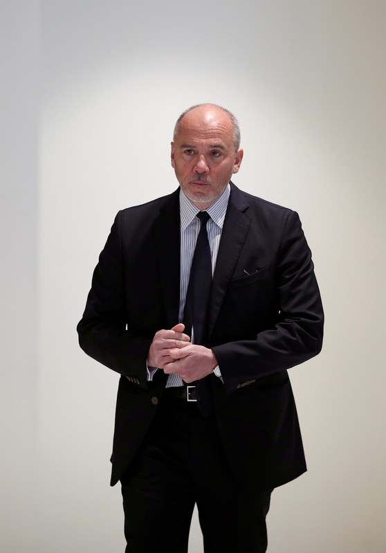 French telecom group Orange CEO Stephane Richard arrives for a trial over a disputed state payment at the Paris courthouse
