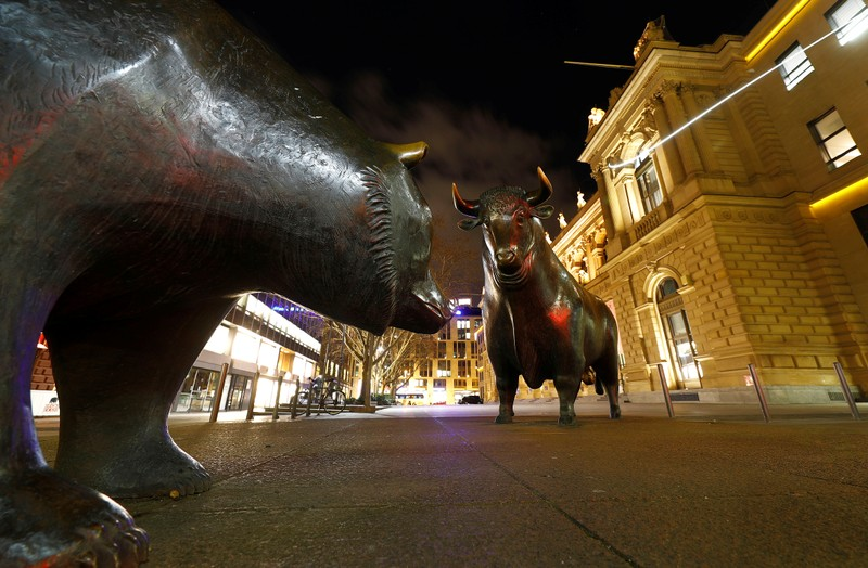 Bull and bear symbols for successful and bad trading are seen in front of the German stock exchange (Deutsche Boerse) in Frankfurt