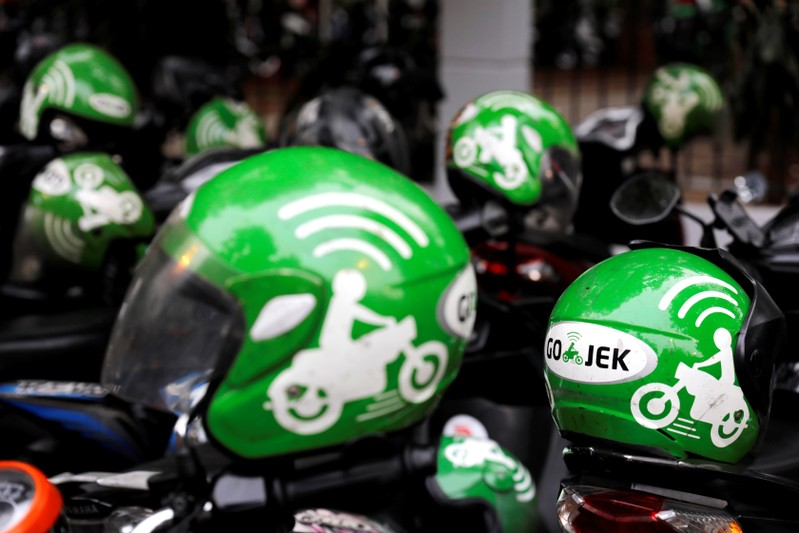 Gojek driver helmets are seen during Go-Food festival in Jakarta