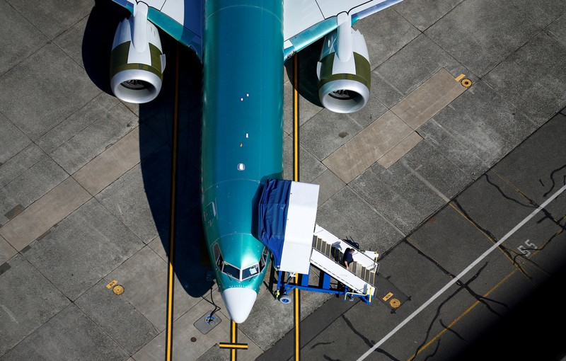 An unpainted Boeing 737 MAX aircraft is parked at Renton Municipal Airport near the Boeing Renton facility in Renton