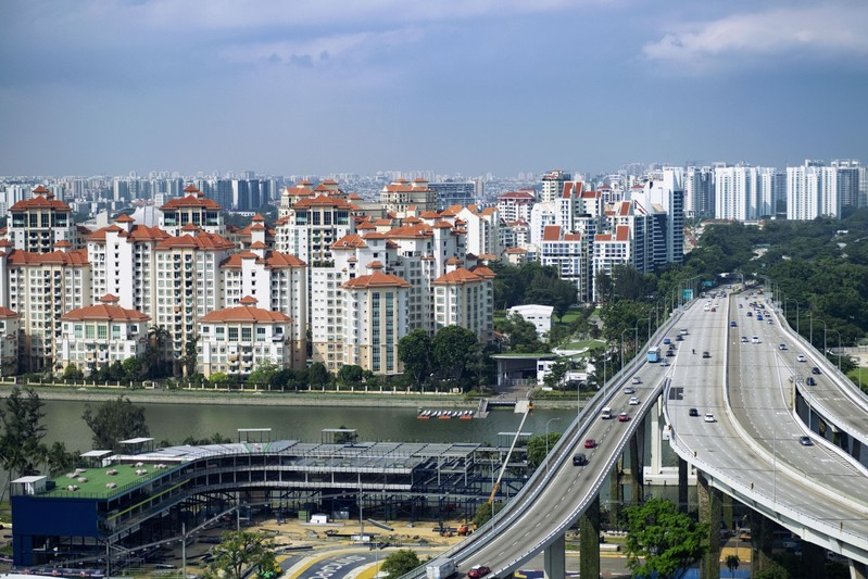 FILE PHOTO: Vehicles travel on the Benjamin Sheares Bridge past the Marina Centre precinct and luxury waterfront condominiums of the Tanjong Rhu subzone in Singapore