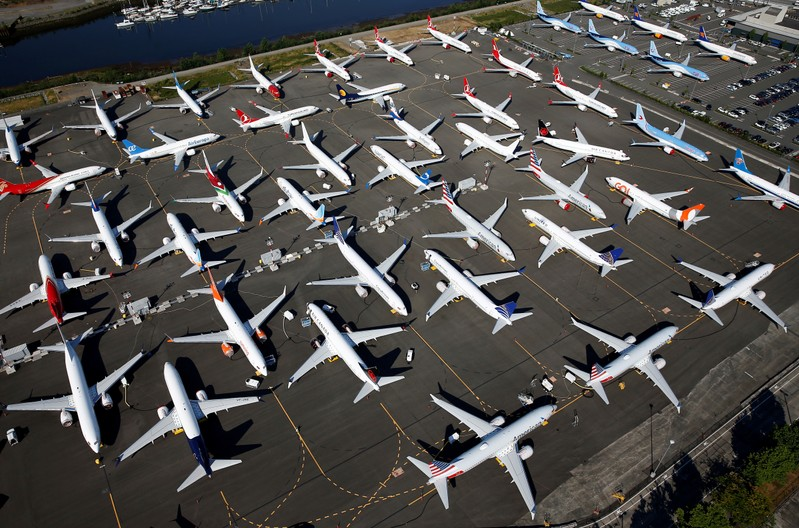 FILE PHOTO: Dozens of grounded Boeing 737 MAX aircraft are seen parked at Boeing Field in Seattle