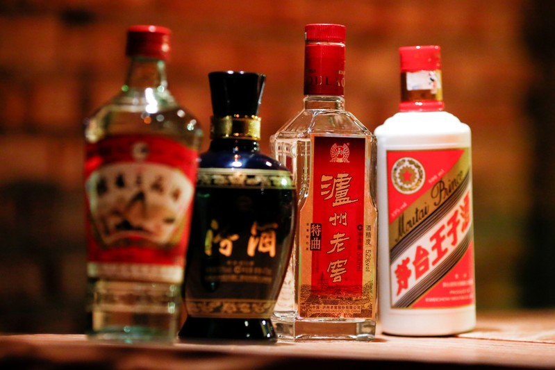 FILE PHOTO: Bottles of the Chinese spirit baijiu are on display at a bar in Beijing
