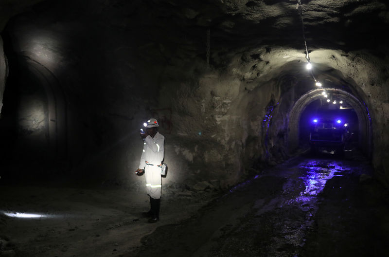 A mine worker is seen under ground at Cullinan mine, near Pretoria