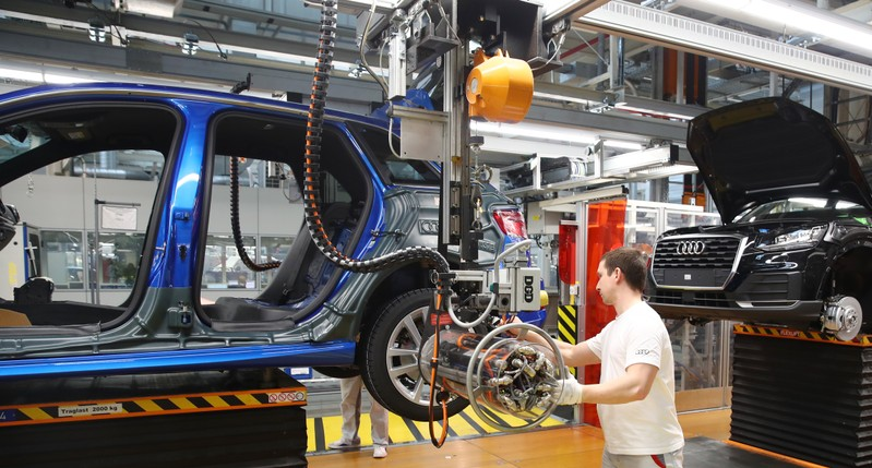 Worker assembles a new Audi at the production line of the German car manufacturer's plant in Ingolstadt