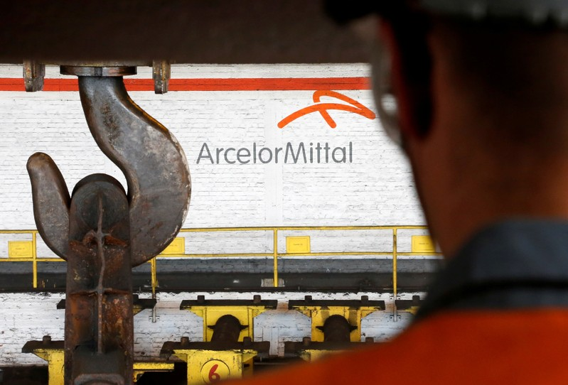 FILE PHOTO: A worker surveys the production process at the ArcelorMittal steel plant in Ghent