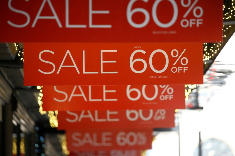 FILE PHOTO: Sale signs are displayed at the front of a shop, in London