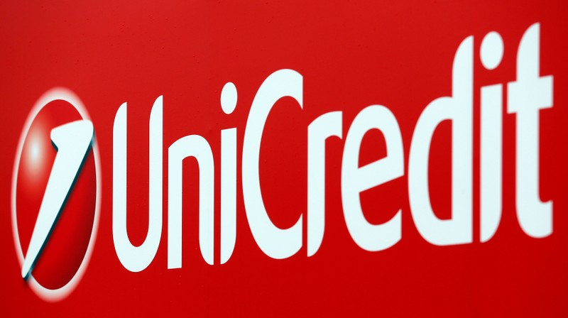Unicredit bank logo is seen on a banner downtown Milan