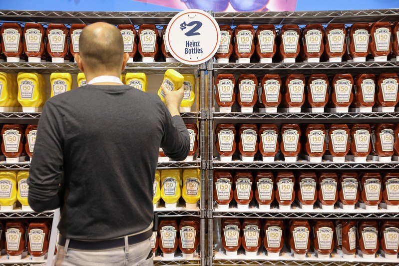 FILE PHOTO: Shareholders shop for discounted products at the Kraft Heinz booth at the annual Berkshire Hathaway shareholder meeting in Omaha