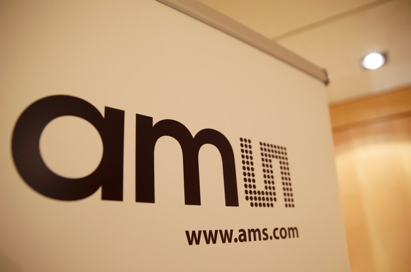 Logo of the multinational semiconductor manufacturer AMS (Austria Mikro Systeme) is seen during a annual news conference, in Zurich