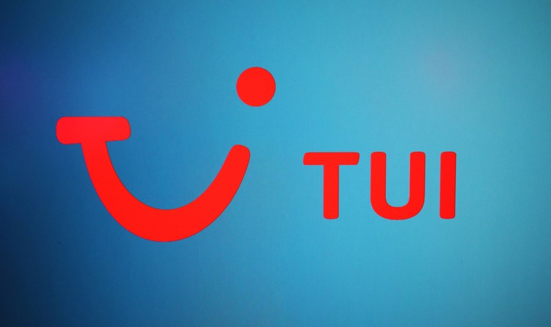 The TUI logo is displayed on a computer screen in London
