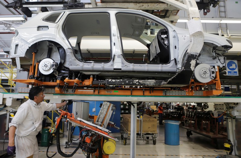 An employee works on the production line of the Volkswagen Tiguan cars at the company's assembly plant in Puebla,