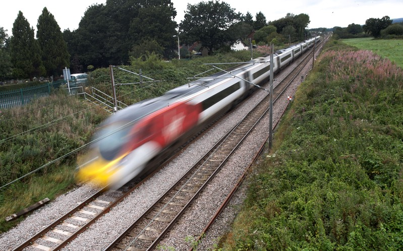 A Virgin Train travels along the West Coast Mainline near Preston