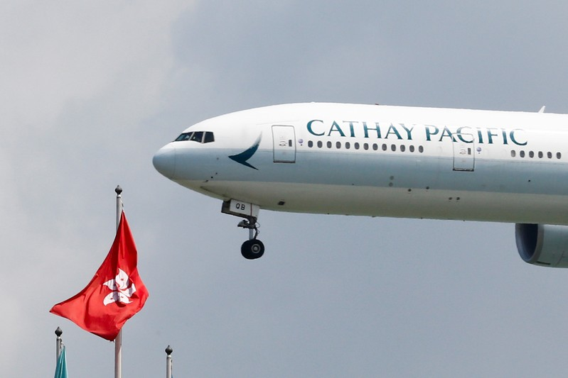 A Cathay Pacific Boeing 777 plane lands at Hong Kong airport after it reopened following clashes between police and protesters