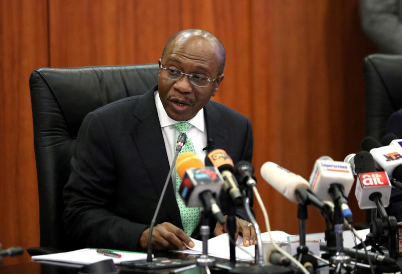 FILE PHOTO: Nigeria's Central Bank Governor Godwin Emefiele speaks during the monthly Monetary Policy Committee meeting in Abuja