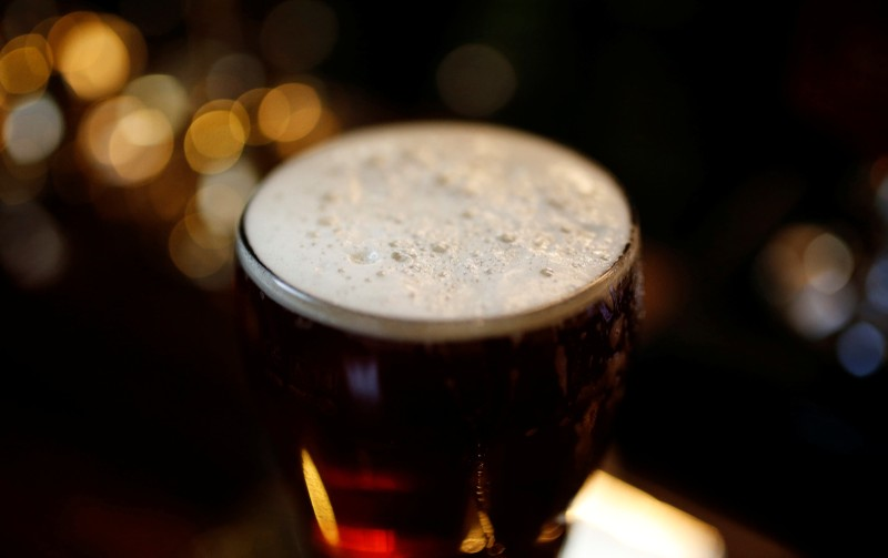 FILE PHOTO: A pint of beer stands on a bar in a pub in Liverpool, northern England