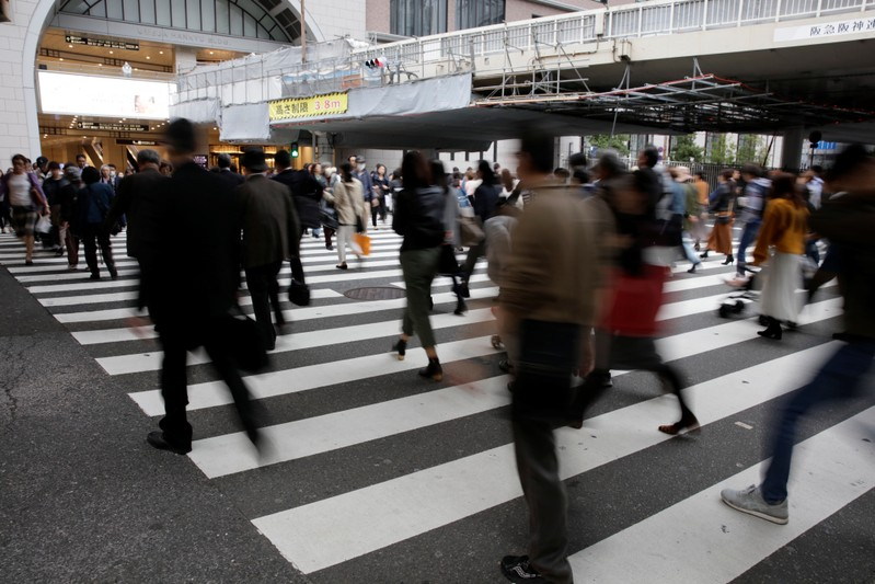 Commuters cross a pedestrian crossing in Osaka