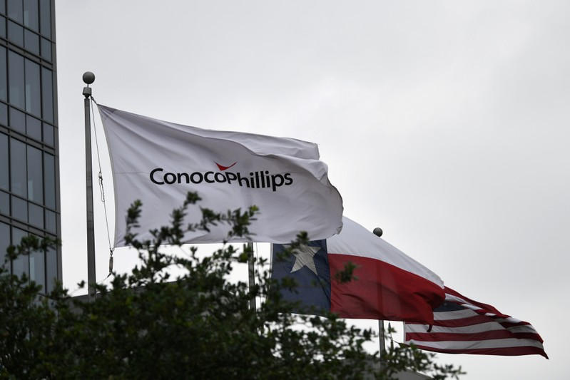 FILE PHOTO: Flags fly outside ConocoPhillips offices in Houston