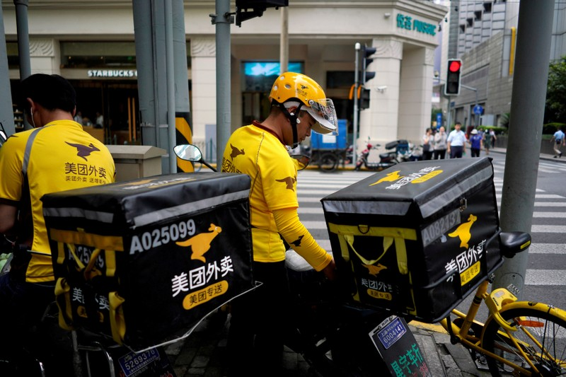 FILE PHOTO: Drivers of food delivery service Meituan are seen in Shanghai