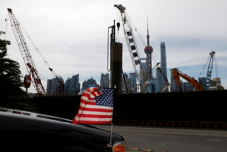 FILE PHOTO: U.S. flag on an embassy car is seen outside a hotel in Shanghai
